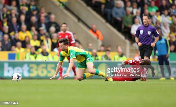 Norwich City's Jonny Howson is challenged by West Bromwich Albion's Steven Reid during the Barclays Premier League match against West Bromwich Albion...