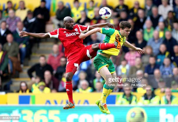 Norwich City's Jonny Howson is challenged by West Bromwich Albion's Yousouff Mulumbu during the Barclays Premier League match against West Bromwich...