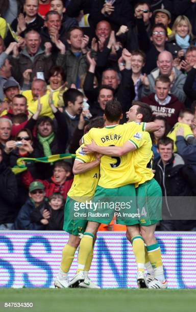 Norwich City's Jonny Howson is congratulated by team mates after scoring during the Barclays Premier League match at Carrow Road Norwich