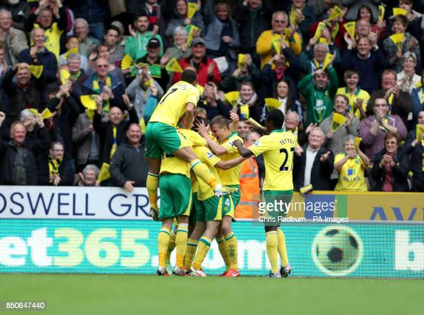 Norwich City's Jonny Howson is congratulated by team mates as he celebrates his goal during the Barclays Premier League match at Carrow Road Norwich