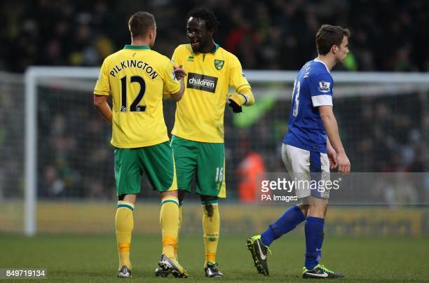 Norwich City's Kei Kamara celebrates scoring the equalising goal with team mate Anthony Pilkington as Everton's Seamus Coleman stands dejected during...