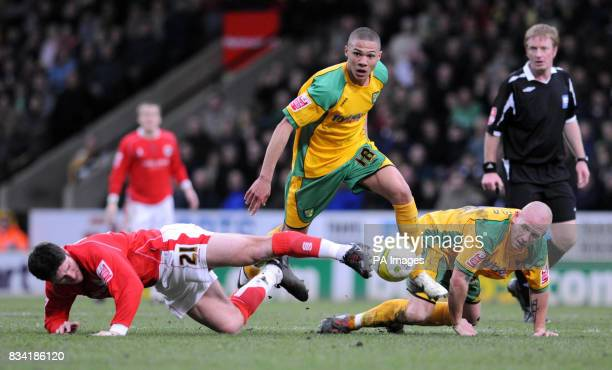 Norwich City's Kieran Gibbs gets the better of Barnsley's Jon Macken during the CocaCola Championship match at Carrow Road Norwich