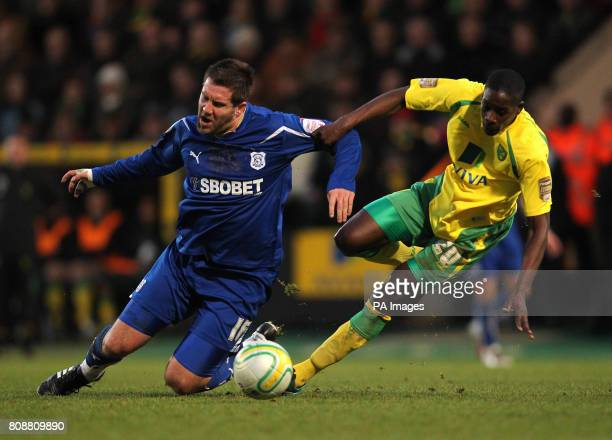 Norwich City's Leon Barnett and Cardiff City's Jon Parkin battle for the ball during the npower Championship match at Carrow Road Norwich