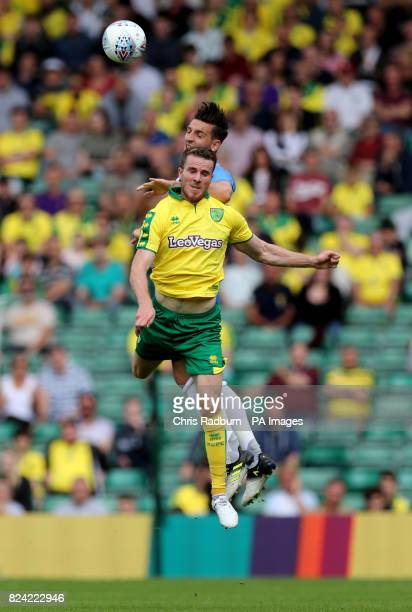 Norwich City's Marley Watkins is challenged by Brighton's Lewis Dunk during the preseason match at Carrow Road Norwich