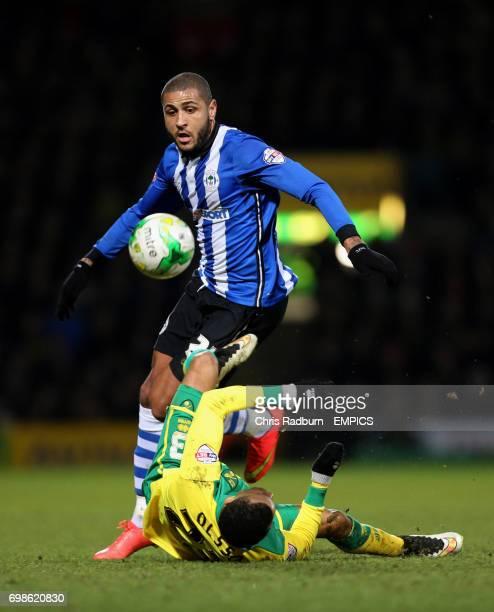 Norwich City's Martin Olsson and Wigan Athletic's Leon Clarke