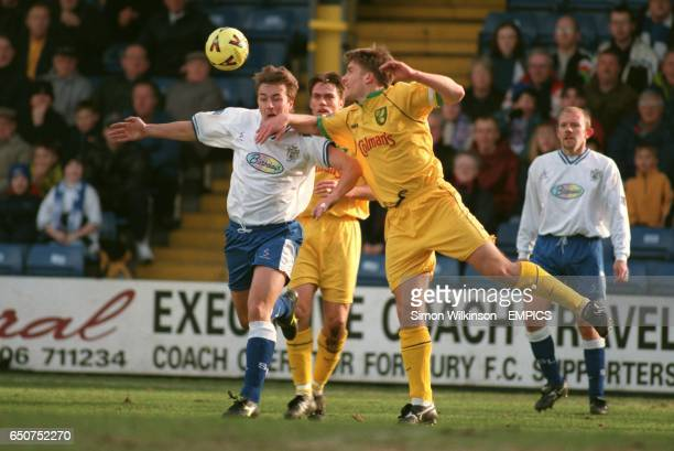 Norwich City's Matt Jackson gets the ball away from Burys Andy Woodward