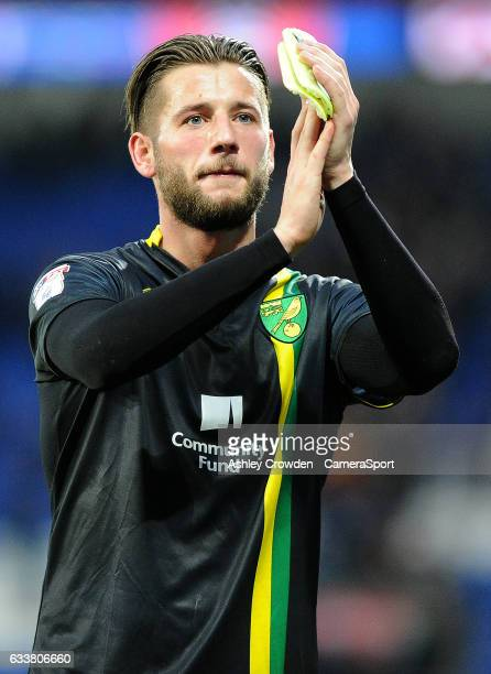 Norwich City's Mitchell Dijks applauds the traveling fans at the end of the match during the Sky Bet Championship match between Cardiff City and...