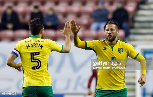 Norwich City's Mitchell Dijks celebrates scoring his side's second goal of the game with Russell Martin during the Sky Bet Championship match at the...