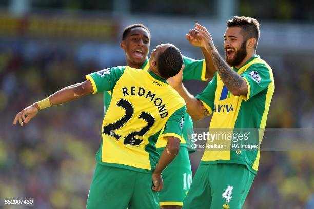 Norwich City's Nathan Redmond celebrates scoring the opening goal of the game with Leroy Fer and Bradley Johnson