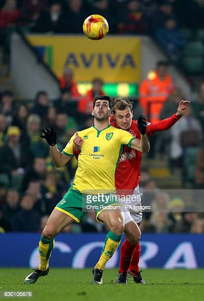 Norwich City's Nelson Oliveira and Huddersfield Town's Jon Gorenc Stankovic battle for the ball during the Sky Bet Championship match at Carrow Road...