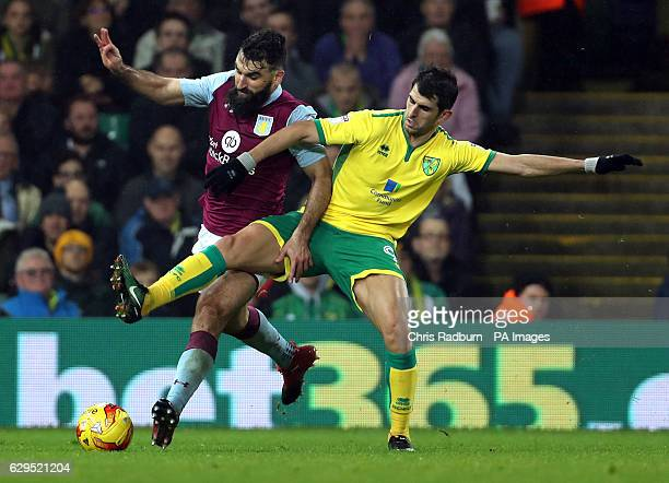 Norwich City's Nelson Oliveira challenges Aston Villa's Mile Jedinak during the Sky Bet Championship match at Carrow Road Norwich
