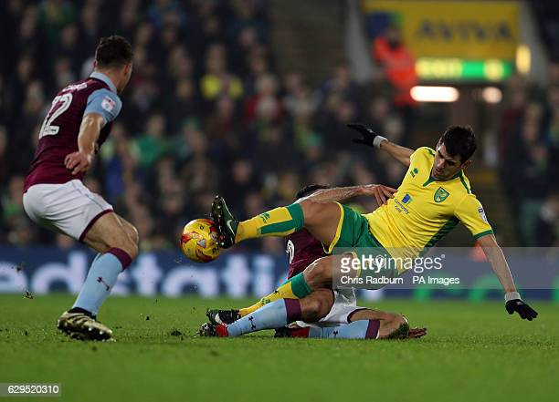 Norwich City's Nelson Oliveira is fouled by Aston Villa's Mile Jedinak during the Sky Bet Championship match at Carrow Road Norwich
