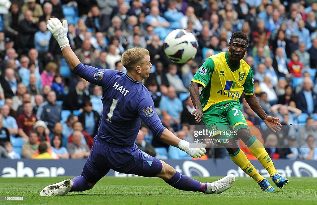 "Norwich City's Norwegian midfielder Alexander Tettey (R) shoots wide past Manchester City's English goalkeeper Joe Hart during the English Premier League football match between Manchester City and Norwich City at the Etihad Stadium in Manchester, northwest England, on May 19, 2013. Norwich won the match 3-2. USE. No use with unauthorized audio, video, data, fixture lists, club/league logos or ""live"" services. Online in-match use limited to 45 images, no video emulation. No use in betting, games or single club/league/player publications."