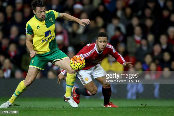 Norwich City's Russell Martin and Manchester United's Memphis Depay in action