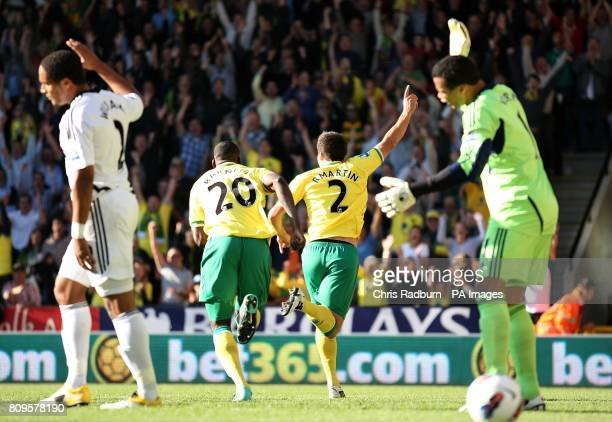 Norwich City's Russell Martin celebrates after scoring the second goal of the game as Swansea City goalkeeper Michel Vorm reacts
