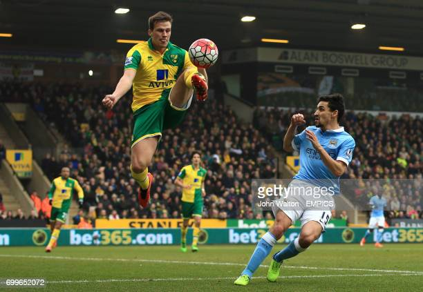 Norwich City's Ryan Bennett and Manchester City's Jesus Navas battle for the ball