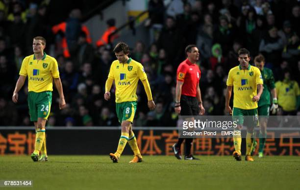 Norwich City's Ryan Bennett Jonny Howson and Javier Garrido stand dejected after conceding a goal to Luton Town