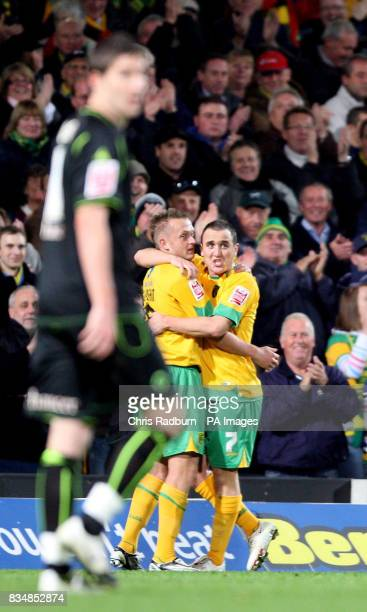 Norwich City's Sammy Clingan is congratulated by team mate Lee Croft after his free was taken over the line by Wolverhampton goal keeper Carl Ikeme...