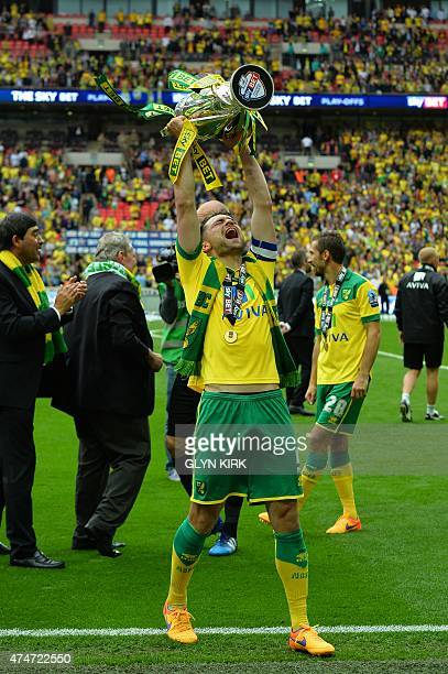 Norwich City's Scottish defender Russell Martin celebrates with the trophy after the official presentation after Norwich City won the English...