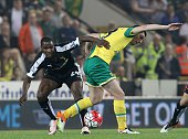 Norwich City's Scottish midfielder Graham Dorrans vies with Watford's Nigerian striker Odion Ighalo during the English Premier League football match...