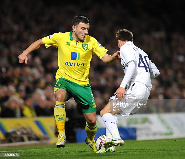 Norwich City's Scottish striker Robert Snodgrass vies with Tottenham Hotspur's English midfielder Tom Carroll during the English League Cup Fourth...