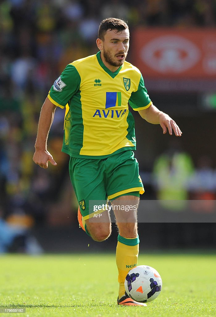 Norwich City's Scottishstriker Robert Snodgrass runs with the ball during their English Premier League football match at Carrow Road in Norwich, England, on 31 August, 2013. USE. No use with unauthorized audio, video, data, fixture lists, club/league logos or 'live' services. Online in-match use limited to 45 images, no video emulation. No use in betting, games or single club/league/player publications