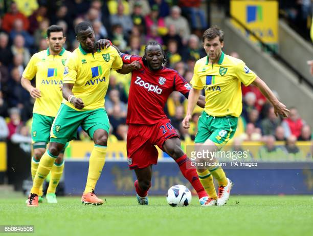 Norwich City's Sebastien Bassong and Jonny Howson challenge for the ball against West Bromwich Albion's Romelu Lukaku during the Barclays Premier...