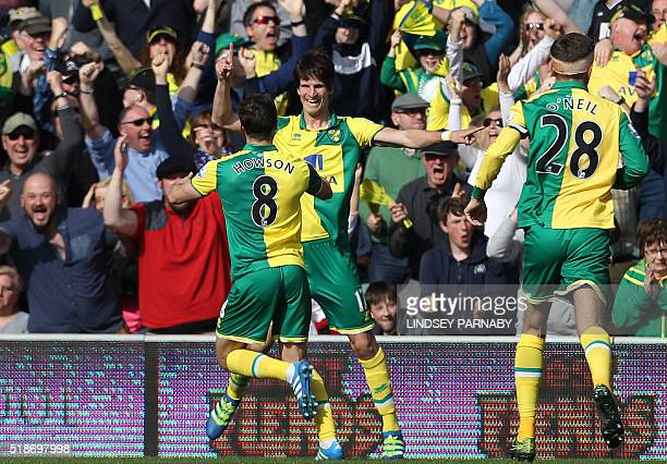 Norwich Citys Swiss midfielder Timm Klose celebrates after scoring during the English Premier League football match between Norwich City and...