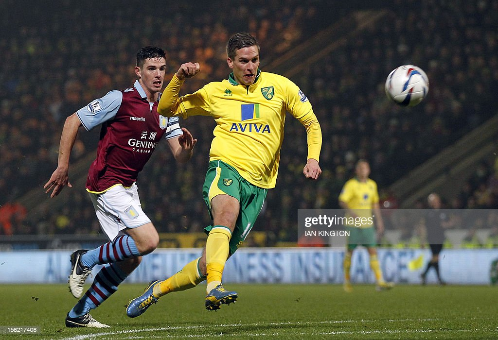 Norwich City's Welsh striker Steve Morison (R) scores his team's first goal against Aston Villa during their English League Cup quarter final football match at Carrow Road stadium in Norwich, east England, on December 12, 2012.