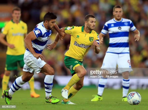Norwich City's Wes Hoolahan and Queens Park Rangers' Massimo Luongo battle for the ball during the Sky Bet Championship match at Carrow Road Norwich