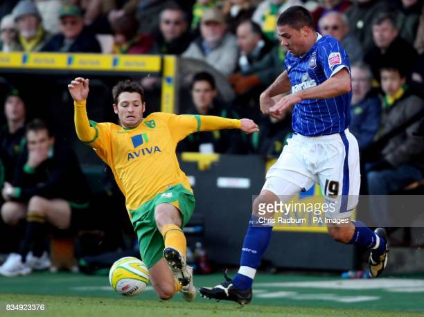 Norwich City's Wesley Hoolahan tackles Ipswich Town's Jonathan Walters during the CocaCola Championship match at Carrow Road Norwich