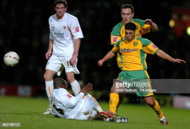 Norwich City's Youssef Safri tussels with Blackpool's Adrian Forbes during the FA Cup fourth round replay at Carrow Road Norwich