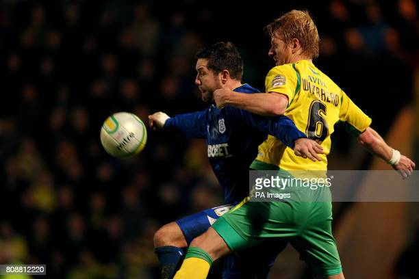 Norwich City's Zak Whitbread and Cardiff City's Jon Parkin battle for the ball during the npower Championship match at Carrow Road Norwich