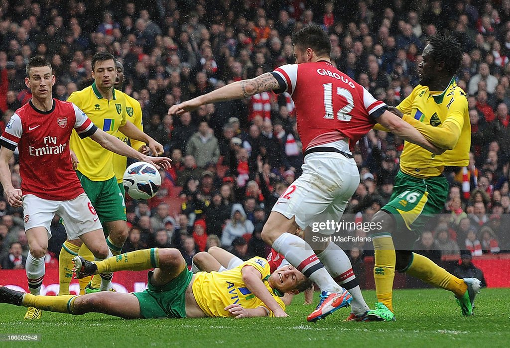 Norwich defender Alexander Tettey pulls back <a gi-track='captionPersonalityLinkClicked' href=/galleries/search?phrase=Olivier+Giroud&family=editorial&specificpeople=5678034 ng-click='$event.stopPropagation()'>Olivier Giroud</a> for the Arsenal and concedes a penalty during the Barclays Premier League match between Arsenal and Norwich City at Emirates Stadium on April 13, 2013 in London, England.