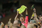 Norwich fan holds up a banner prior to the Barclays Premier League match between Norwich City and Watford at Carrow Road on May 11 2016 in Norwich...
