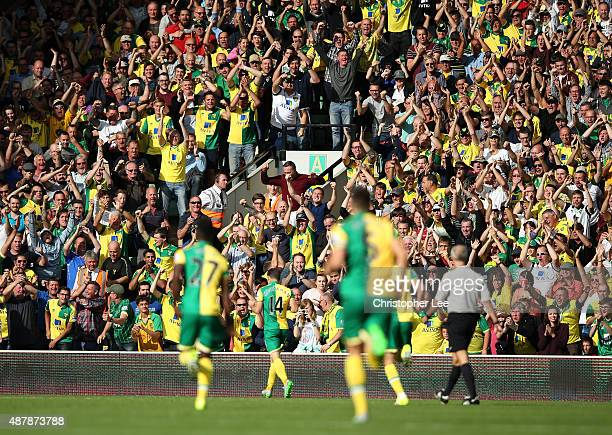 Norwich fans celebrate the second goal scored by Wes Hoolahan during the Barclays Premier League match between Norwich City and AFC Bournemouth at...
