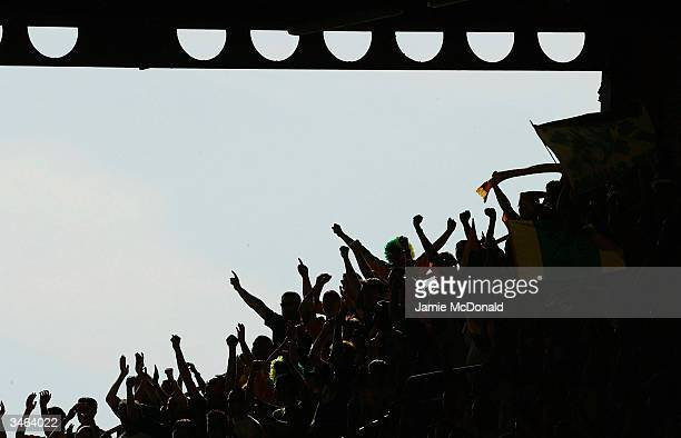 Norwich fans enjoy the moment during the Nationwide Division One match between Watford and Norwich City at Vicarage Road on April 24 2004 in Watford...