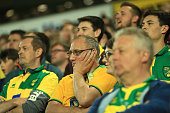 Norwich fans look dejected during the Barclays Premier League match between Norwich City and Watford at Carrow Road on May 11 2016 in Norwich England