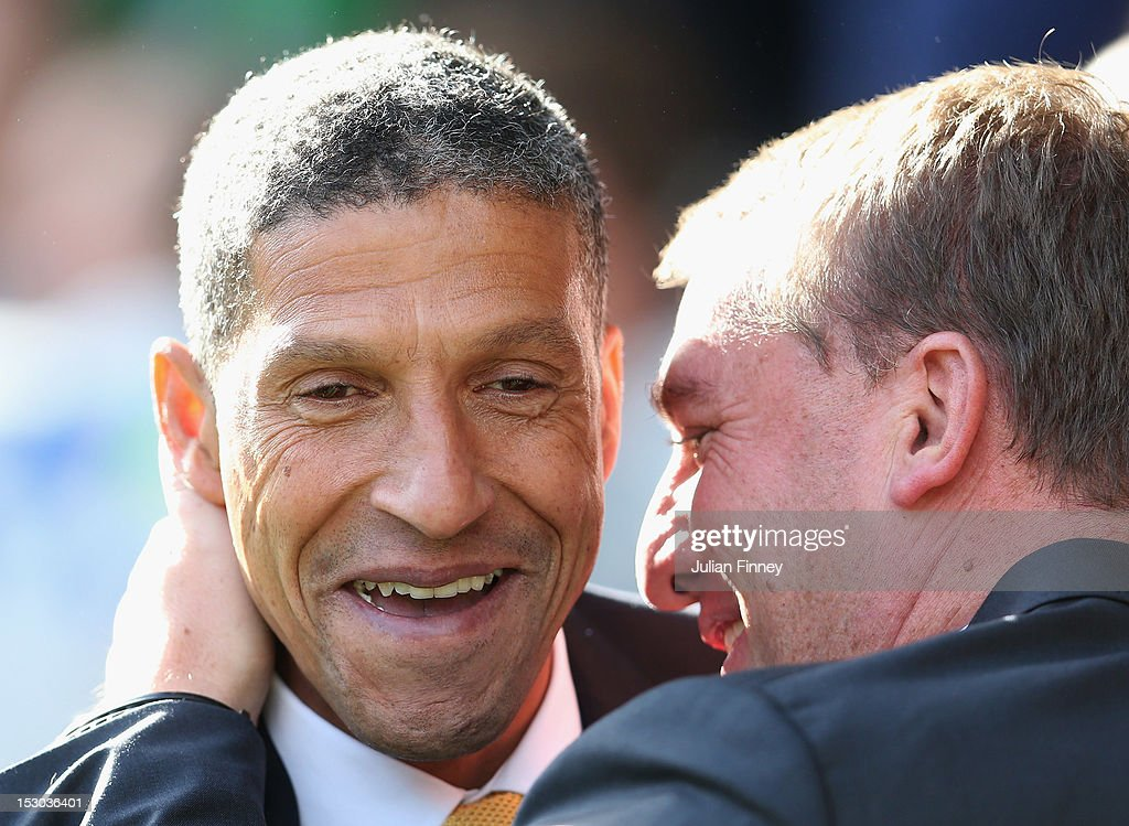 Norwich manager, Chris Hughton meets Liverpool manager, Brendan Rodgers during the Barclays Premier League match between Norwich City and Liverpool at Carrow Road on September 29, 2012 in Norwich, England.