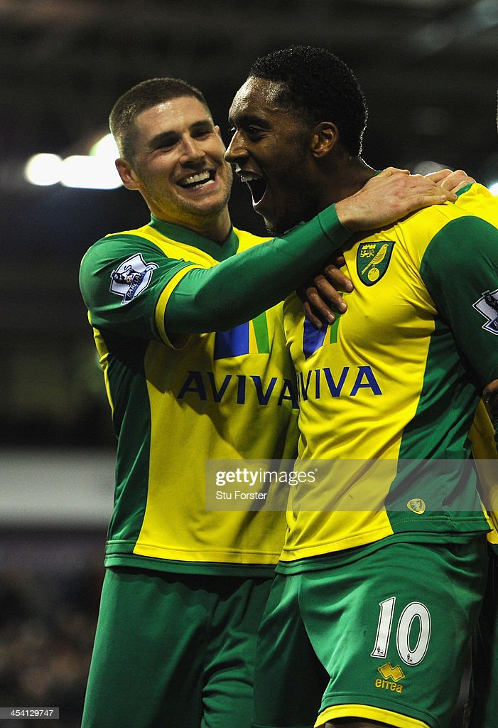 Norwich player <a gi-track='captionPersonalityLinkClicked' href=/galleries/search?phrase=Leroy+Fer&family=editorial&specificpeople=5476889 ng-click='$event.stopPropagation()'>Leroy Fer</a> celebrates after scoring the second goal with Gary Hooper (l) during the Barclays Premier League match between West Bromwich Albion and Norwich City at The Hawthorns on December 7, 2013 in West Bromwich, England.
