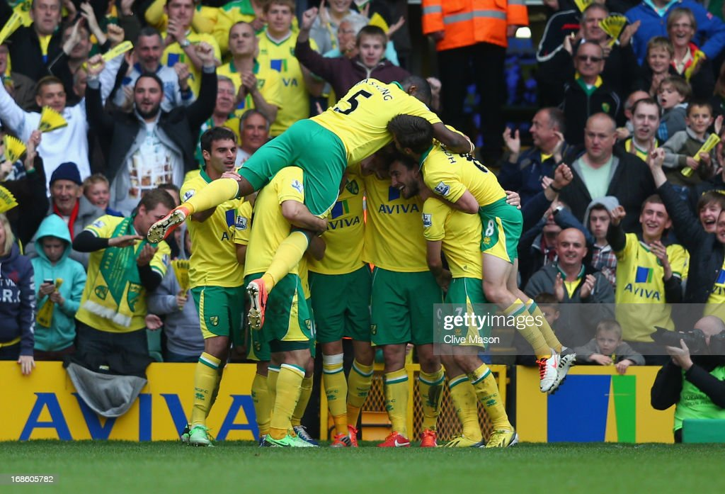 Norwich players celebrate <a gi-track='captionPersonalityLinkClicked' href=/galleries/search?phrase=Grant+Holt&family=editorial&specificpeople=2091078 ng-click='$event.stopPropagation()'>Grant Holt</a>s goal during the Barclays Premier League match between Norwich City and West Bromwich Albion at Carrow Road on May 12, 2013 in Norwich, England.