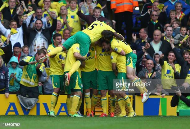 Norwich players celebrate Grant Holts goal during the Barclays Premier League match between Norwich City and West Bromwich Albion at Carrow Road on...