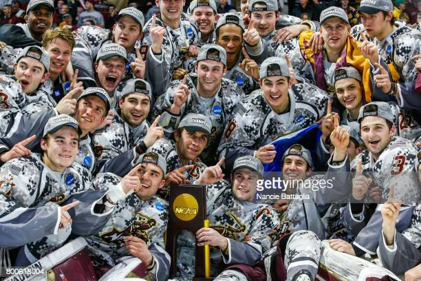 Norwich University celebrates their 41 win over Trinity College in the Division lll Men's Ice Hockey Championship held at the Utica Memorial...