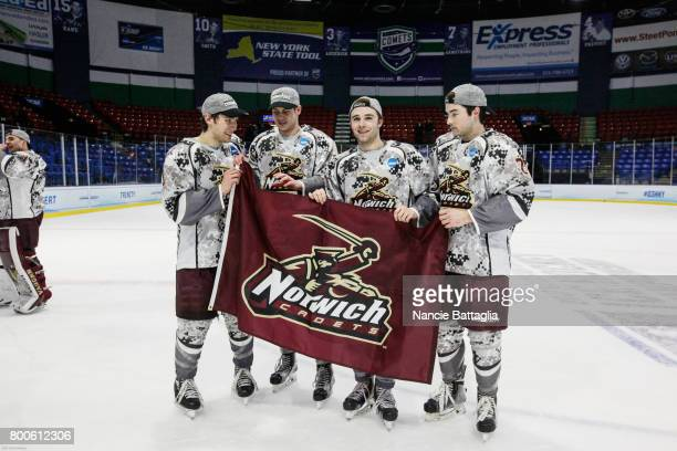Norwich University pose with a team flag after the Division lll Men's Ice Hockey Championship held at the Utica Memorial Auditorium on March 25 2017...