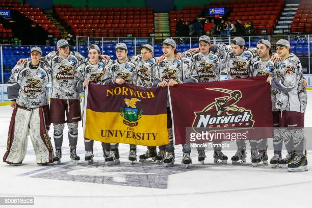 Norwich University pose with team flags after the Division lll Men's Ice Hockey Championship held at the Utica Memorial Auditorium on March 25 2017...