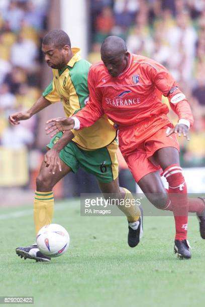 Norwich's David Nielsen goes shoulder to shoulder with Gillingham's Nyron Nosworthy during their Nationwide Division One match at Norwich's Carrow...