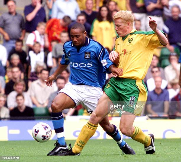USE Norwich's Gary Holt puts Manchester City's Jeff Whiteley under pressure during the Nationwide Football League Division One football match at...
