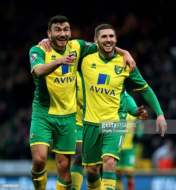 Norwich's Gary Hooper celebrates scoring the first goal of the game with team mate Robert Snodgrass during the Barclays Premier League match between...