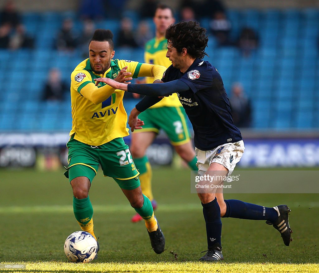 Norwich's Nathan Redmond looks to break away from Millwall's Diego Fabbrini during the Sky Bet Championship match between Millwall and Norwich City at The Den on March 07, 2015 in London, England.