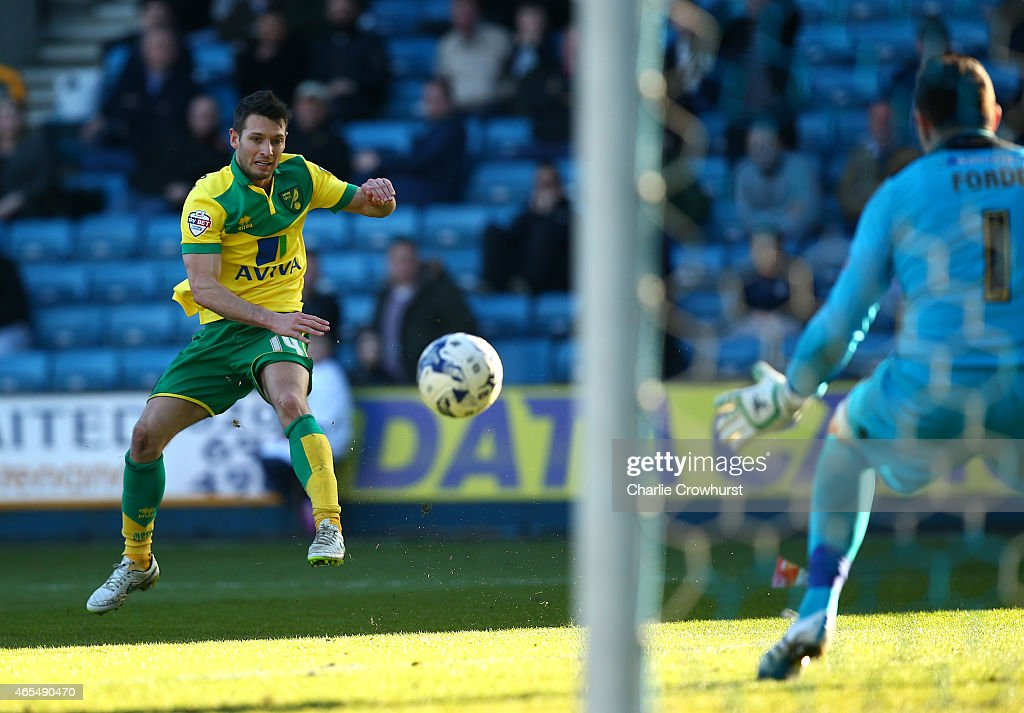Norwich's Wes Hoolahan watches his shot as he scores the teams third goal of the game during the Sky Bet Championship match between Millwall and Norwich City at The Den on March 07, 2015 in London, England.